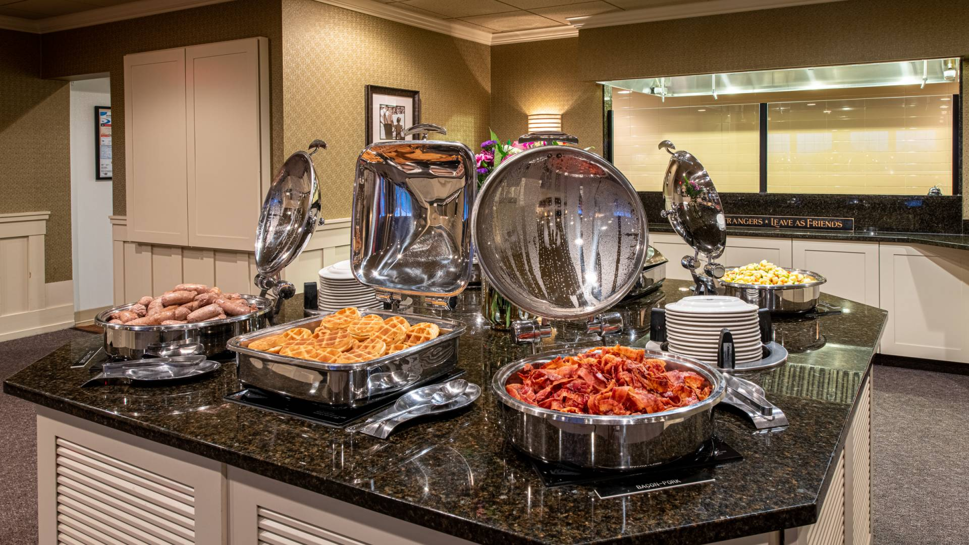 complimentary breakfast buffet with sausage links, waffles, bacon, eggs and more setup