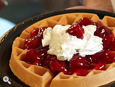 waffle with cherries & whipped cream